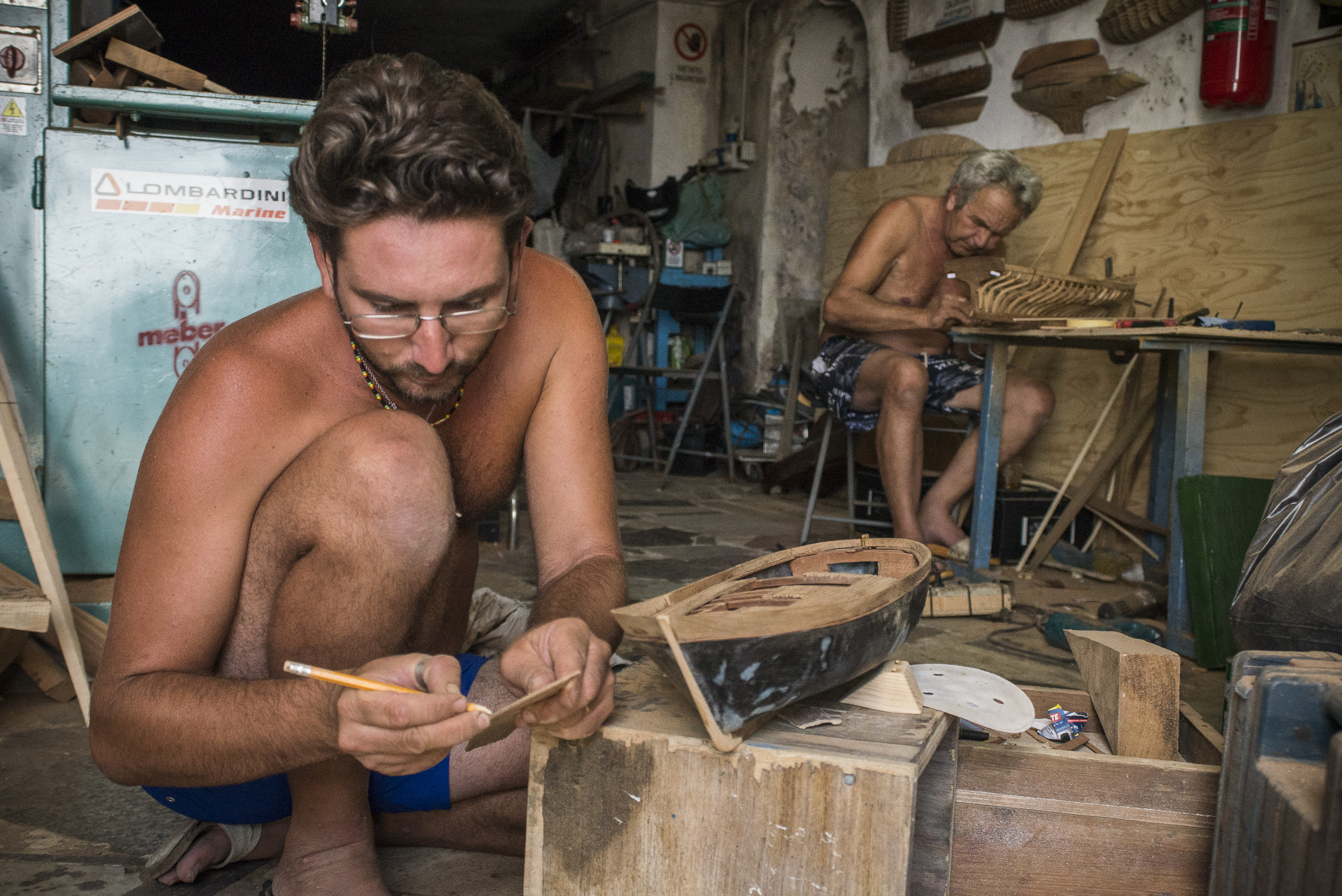 Local shipwrights  they work to create a boat of modeling on Porto Corricella in Procida, Italy